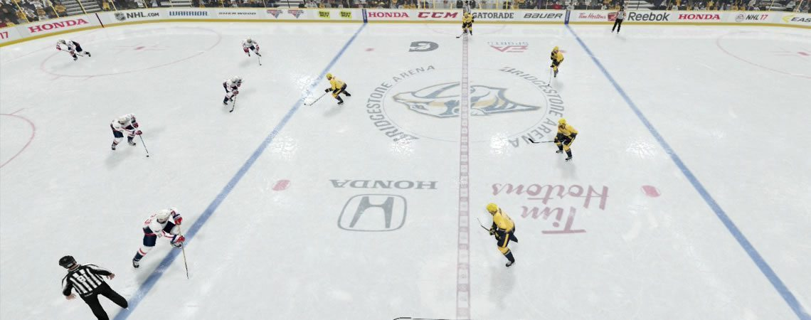 4 players lined up across the defensive blue line with 1 defender pressuring the puck carrier. The 1-4 neutral zone trap.