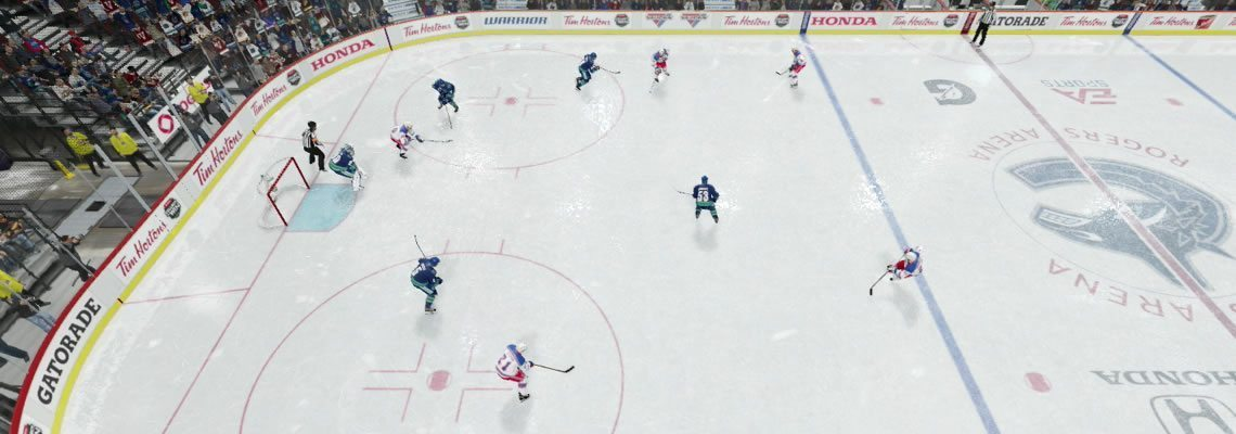 Large Box penalty kill formation with defenders attacking the puck carrier